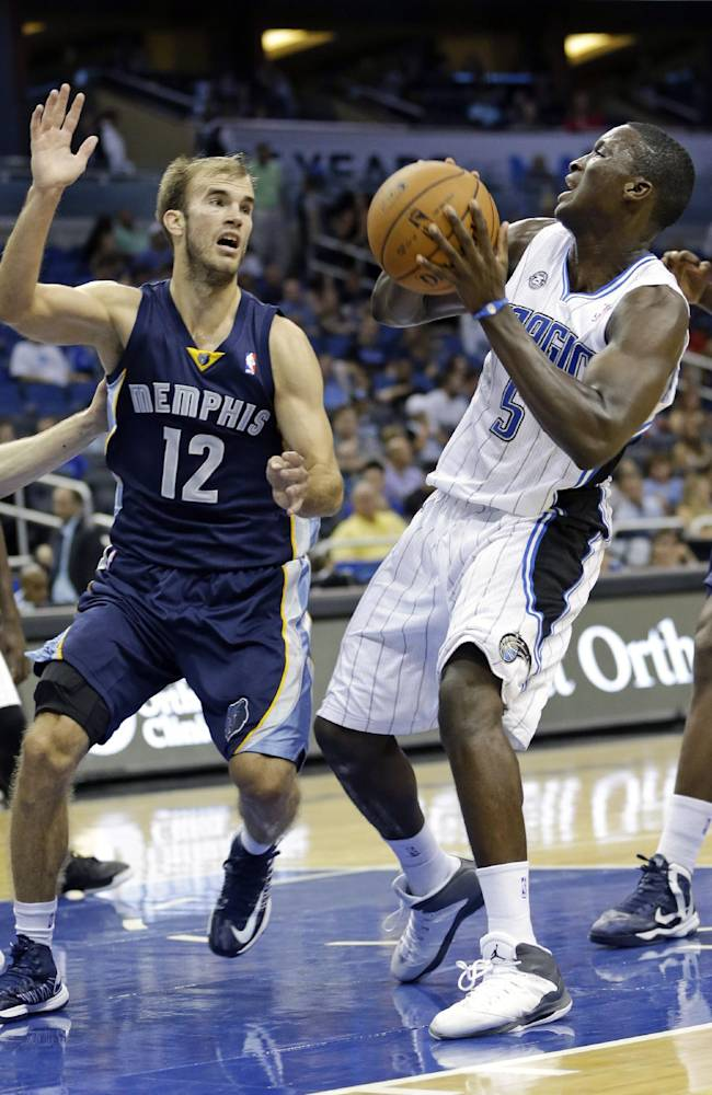 Orlando Magic's Victor Oladipo (5) pulls up to take a shot over Memphis Grizzlies' Nick Calathes (12) during the second half of an NBA preseason basketball game in Orlando, Fla., Friday, Oct. 18, 2013. The Memphis Grizzlies won the game 97-91