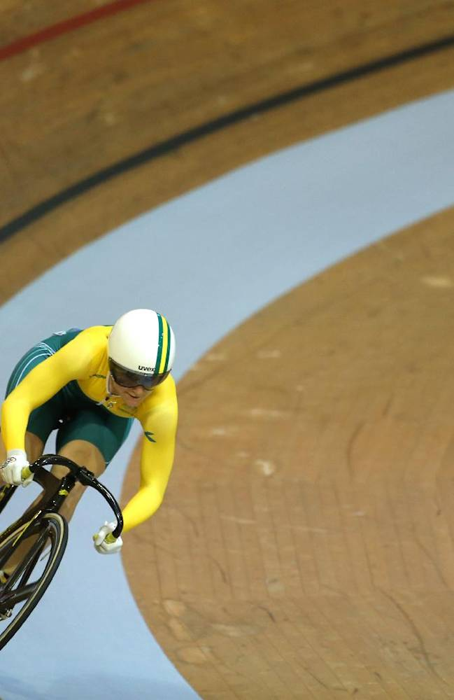 Australia's Anna Meares, right, and Scotland's Jenny Davis compete in the Women's sprint quarterfinal at the Chris Hoy velodrome at the Commonwealth Games Glasgow 2014, Scotland, Saturday July 26, 2014