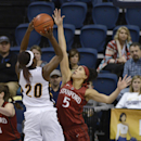 Stanford's Kaylee Johnson (5) blocks a shot by Chattanooga's Keiana Gilbert (20) during the first half of an NCAA college basketball game Wednesday, Dec. 17, 2014, in Chattanooga, Tenn. (AP Photo/Billy Weeks)