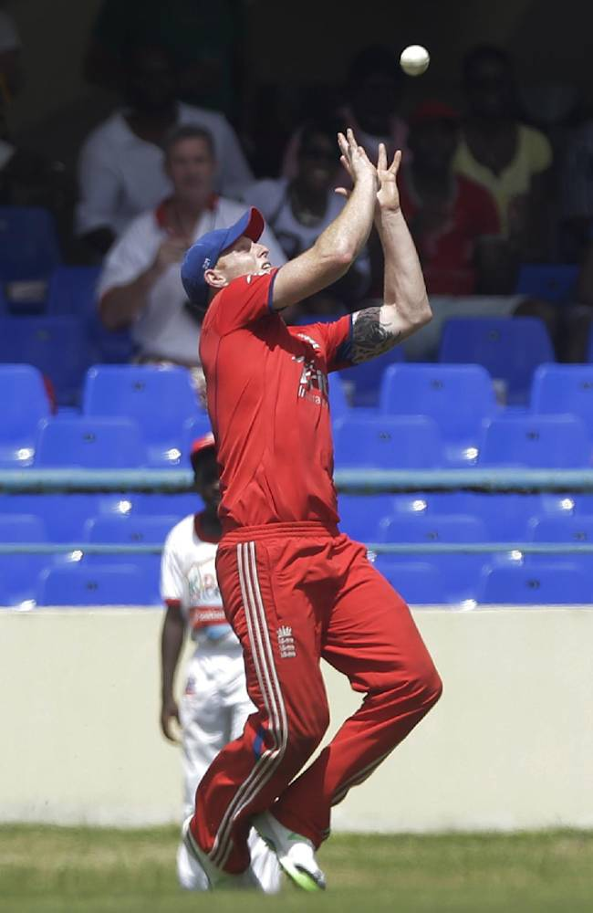 England's Ben Stokes catches West Indies' Lendl Simmons during their second one-day international cricket match at the Sir Vivian Richards Cricket Ground in St. John's, Antigua, Sunday, March 2, 2014