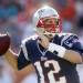 FILE - In this Dec. 2, 2012, file photo, New England Patriots quarterback Tom Brady looks for a receiver during the second half of an NFL football game against the Miami Dolphins in Miami. Brady agreed to a three-year contract extension with New England on Monday, Feb. 25, 2013, a person familiar with the contract told The Associated Press. The extension is worth about $27 million and will free up nearly $15 million in salary cap room for the team. (AP Photo/John Bazemore, File)