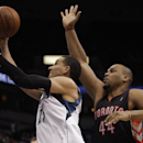 Minnesota Timberwolves guard Kevin Martin (23) pushes up to the basket past Toronto Raptors forward Chuck Hayes (44) in the second half of an NBA basketball game, Sunday, March 9, 2014, in Minneapolis. The Raptors won 111-104 The Associated Press