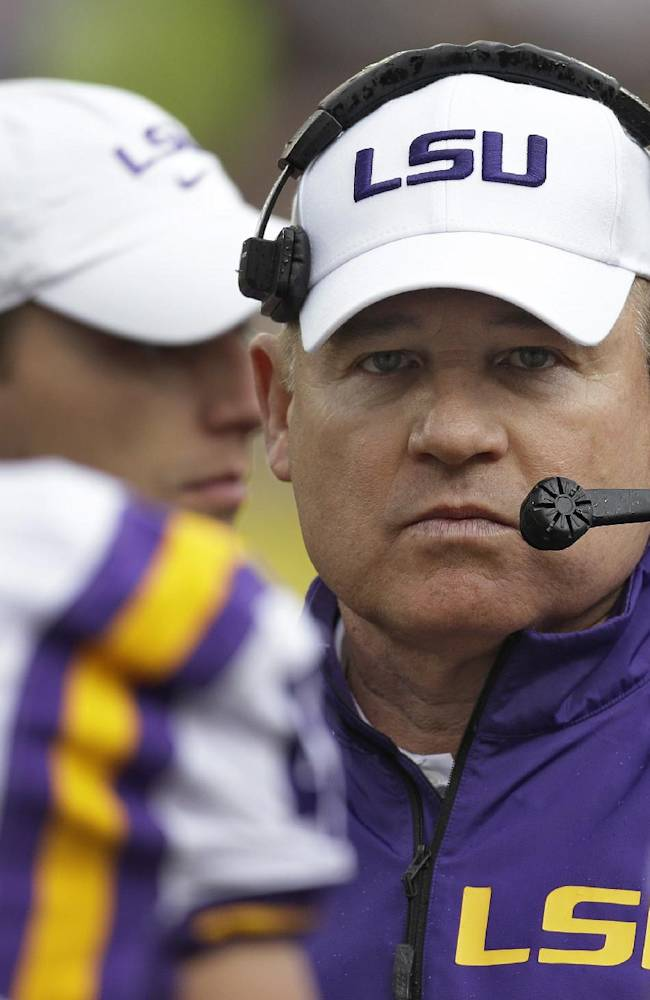 LSU head coach Les Miles talks to his team during the second quarter of the Outback Bowl NCAA college football game against Iowa Wednesday, Jan. 1, 2014, in Tampa, Fla