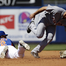 New York Mets' Juan Lagares, left, steals second base as the ball gets by Detroit Tigers' Steve Lombardozzi, right, on a throwing error by catcher Bryan Holaday in the third inning of an exhibition spring training baseball game, Tuesday, March 18, 2014, i