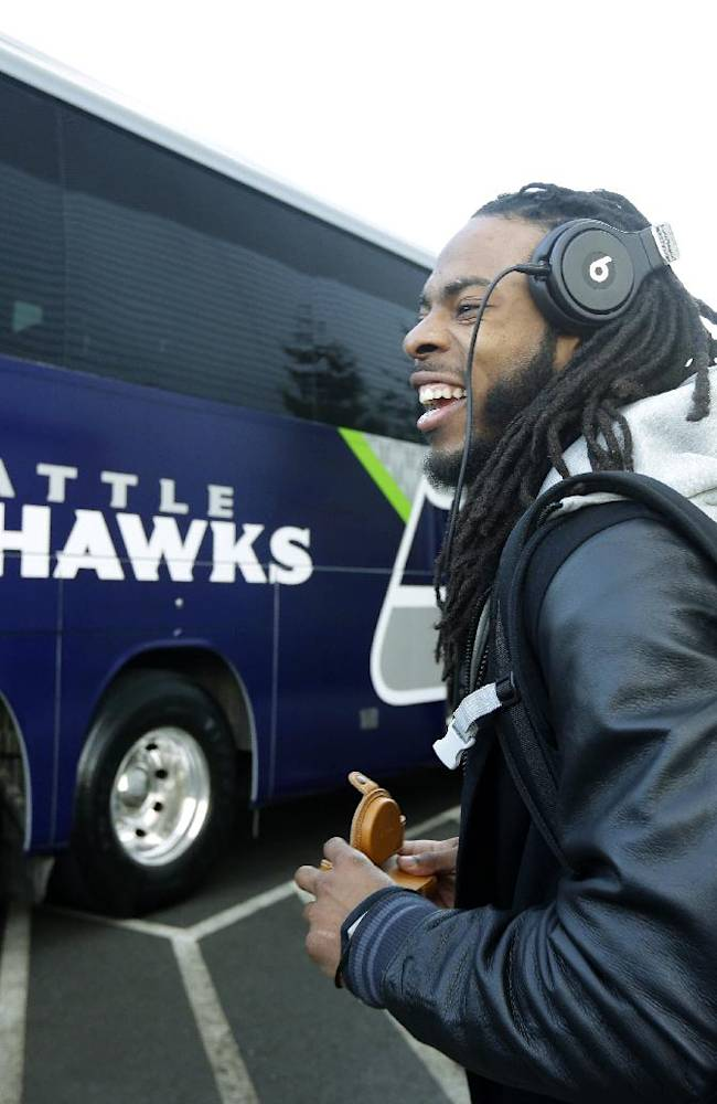Seattle Seahawks cornerback Richard Sherman leaves team headquarters in Renton, Wash., Sunday, Jan. 26, 2014, to board a bus for his flight to play the Denver Broncos in the NFL Super Bowl XLVIII football game in East Rutherford, N.J