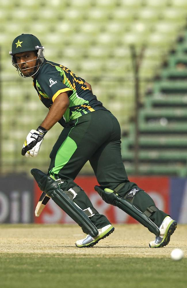 Pakistan's Sharjeel Khan runs after playing a shot during their match against Afghanistan in the Asia Cup one-day international cricket tournament in Fatullah, near Dhaka, Bangladesh, Thursday, Feb. 27, 2014