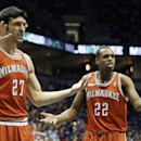 Milwaukee Bucks' ZaZa Pachulia (27) and Khris Middleton (22) argue a technical foul call on Pachulia during the first half of an NBA basketball game against the Houston Rockets Saturday, Feb. 8, 2014, in Milwaukee The Associated Press