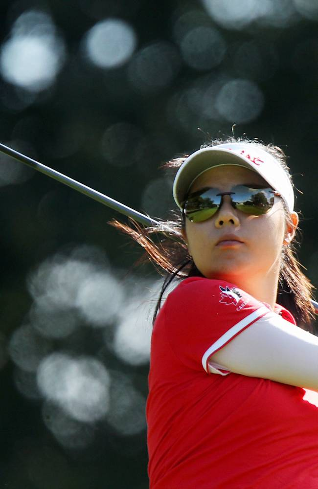 Sue Kim, of Canada, hits her tee shot on the 17th hole at the Canadian Pacific Women's Open golf tournament in London, Ontario, Thursday, Aug. 21, 2014