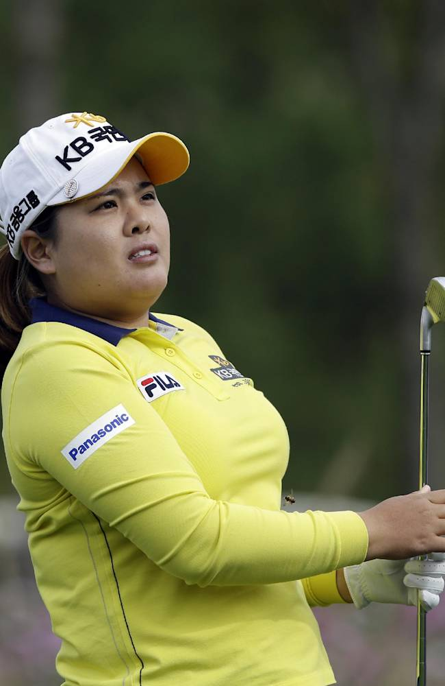 Inbee Park of South Korea watches her shot on the third hole during the second round of the KEB Hana Bank Championship golf tournament at Sky72 Golf Club in Incheon, west of Seoul, South Korea, Saturday, Oct. 19, 2013