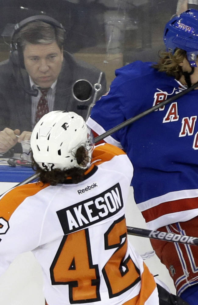 Philadelphia Flyers' Jason Akeson (42) hits New York Rangers' Carl Hagelin (62) in the face with his stick during the third period in Game 1 of an NHL hockey first-round playoff series on Thursday, April 17, 2014, in New York. Akeson was penalized on the play. The Rangers won the game 4-1