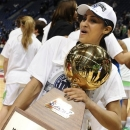 Notre Dame's Skylar Diggins holds up the Big East Conference women's tournament championship trophy after their 61-59 win over Connecticut in an NCAA college basketball game in Hartford, Conn., Tuesday, March 12, 2013. (AP Photo/Jessica Hill)