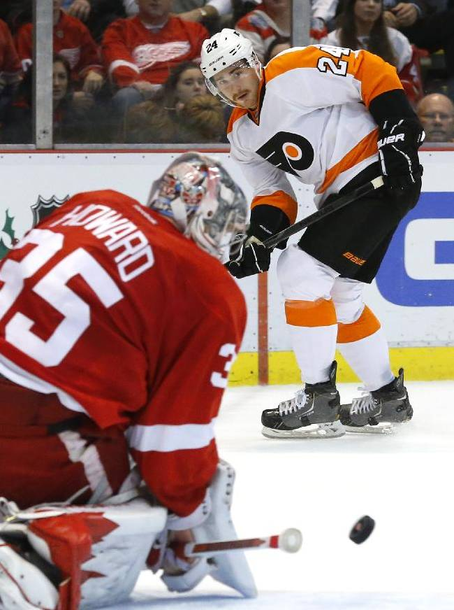 Philadelphia Flyers right wing Matt Read (24) watches his shot stopped by Detroit Red Wings goalie Jimmy Howard (35) in the first period of an NHL hockey game in Detroit, Wednesday, Dec. 4, 2013