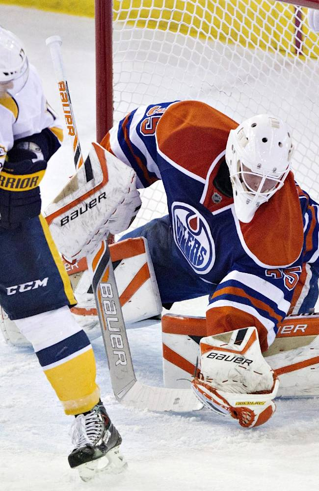 Nashville Predators' Patrick Eaves (17) is stopped by Edmonton Oilers goalie Viktor Fasth (35) during the second period of an NHL hockey game Tuesday, March 18, 2014, in Edmonton, Alberta