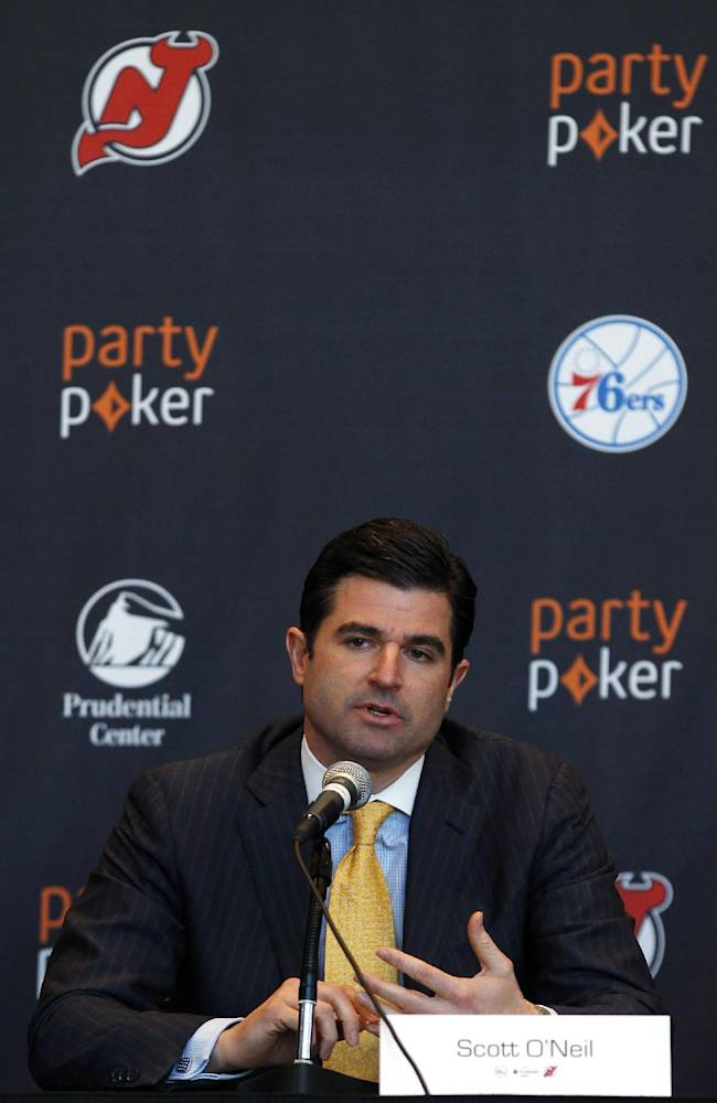 Scott O'Neil, chief executive of the New Jersey Devils, the Prudential Center and the Philadelphia 76ers, speaks during a news conference announcing a deal naming partypoker as the official online gaming partner of the 76ers, the Devils and the Prudential Center on Thursday, Jan. 9, 2014, in Newark, N.J