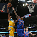 Denver Nuggets forward Darrell Arthur, left, goes up for shot over Detroit Pistons forward Charlie Villanueva as Pistons forward Jonas Jerebko, back, of Sweden, comes in to cover in the fourth quarter of the Nuggets' 118-109 victory in an NBA basketball g