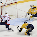 Washington Capitals right wing Troy Brouwer (20) scores past Nashville Predators goalie Carter Hutton (30) and defenseman Ryan Ellis (4) in the first period of an NHL hockey game on Sunday, March 30, 2014, in Nashville, Tenn The Associated Press