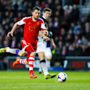 Southampton's Jay Rodriguez, left, gets past Liverpool's Steven Gerrard, during their English Premier League match, at St Mary's, Southampton, England, Saturday March 1, 2014