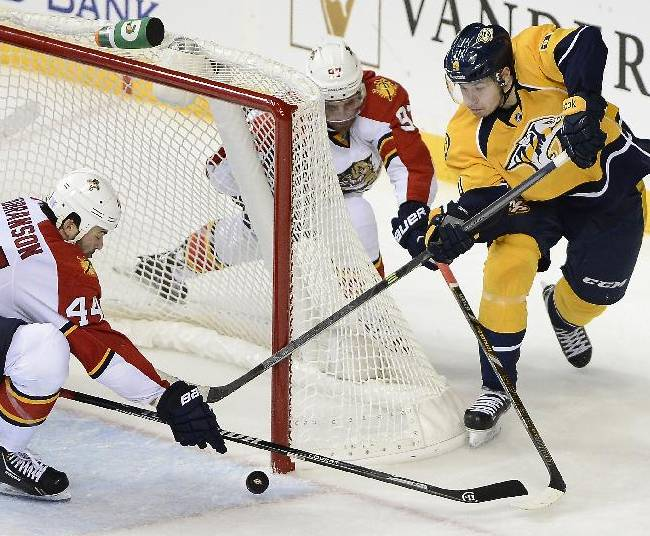 Florida Panthers defenseman Erik Gudbranson (44) blocks a shot by Nashville Predators forward Filip Forsberg (9), of Sweden, during the third period of an NHL hockey game on Tuesday, Oct. 15, 2013, in Nashville, Tenn. Nashville won 4-3