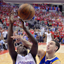 Los Angeles Clippers guard Darren Collison, left, puts up a shot as Golden State Warriors guard Klay Thompson defends during the second half in Game 1 of an opening-round NBA basketball playoff series, Saturday, April 19, 2014, in Los Angeles. The Warrior