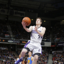 Jimmer Fredette #7 of the Sacramento Kings shoots against the Golden State Warriors on February 19, 2014 at Sleep Train Arena in Sacramento, California. (Photo by Rocky Widner/NBAE via Getty Images)