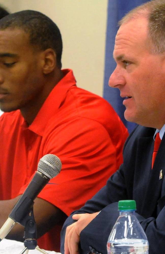 Arizona head coach Rich Rodriguez, right, answer questions as defensive lineman Sione Tuihalamaka, left, wide receiver Terrence Miller listen during a news conference for the AdvoCare V100 Bowl, Monday, Dec. 30, 2013, in Shreveport, La. Arizona is scheduled to play Boston College in the NCAA college football bowl game on Tuesday at Independence Stadium
