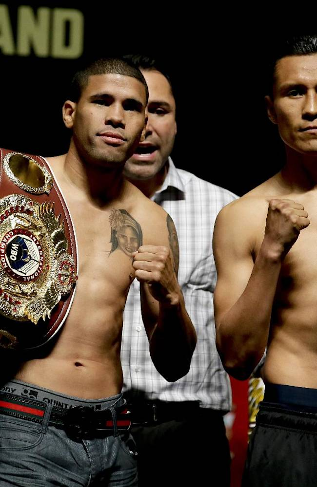 Juan Manuel Lopez, left, and Francisco Vargas pose for the media after the weigh-in for their Saturday bout, Friday, July 11, 2014, in Las Vegas
