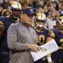 Notre Dame head coach Brian Kelly waits to take the field with his team before an NCAA college football game against Purdue in Indianapolis, Saturday, Sept. 13, 2014. (AP Photo/Michael Conroy)