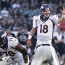 Denver Broncos quarterback Peyton Manning (18) signals at the line of scrimmage behind offensive tackle Ryan Clady (78) against the Oakland Raiders during the third quarter of an NFL football game in Oakland, Calif., Sunday, Nov. 9, 2014. (AP Photo/Marcio Jose Sanchez)