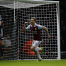 West Ham's Mark Noble, centre, celebrates scoring his side's first goal from the penalty spot as Hull City's goalkeeper Steve Harper reacts after failing to save during the English Premier League soccer match between West Ham and Hull City at Upton Park s