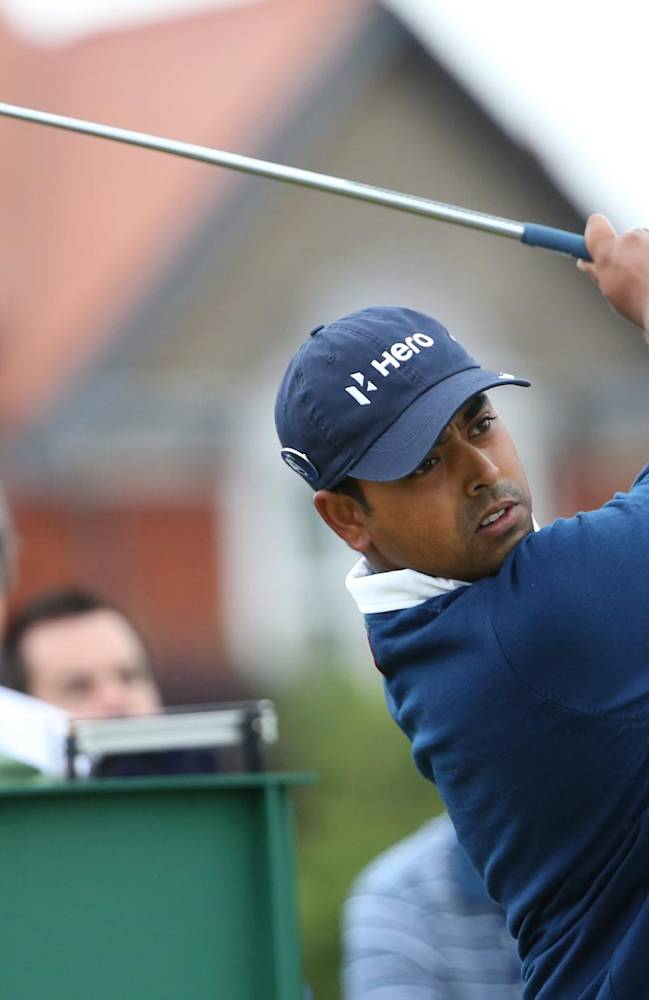 Anirban Lahiri of India plays a shot off the 3rd tee during a practice round ahead of the British Open Golf championship at the Royal Liverpool golf club, Hoylake, England, Wednesday July 16, 2014. The British Open Golf championship starts Thursday July 17
