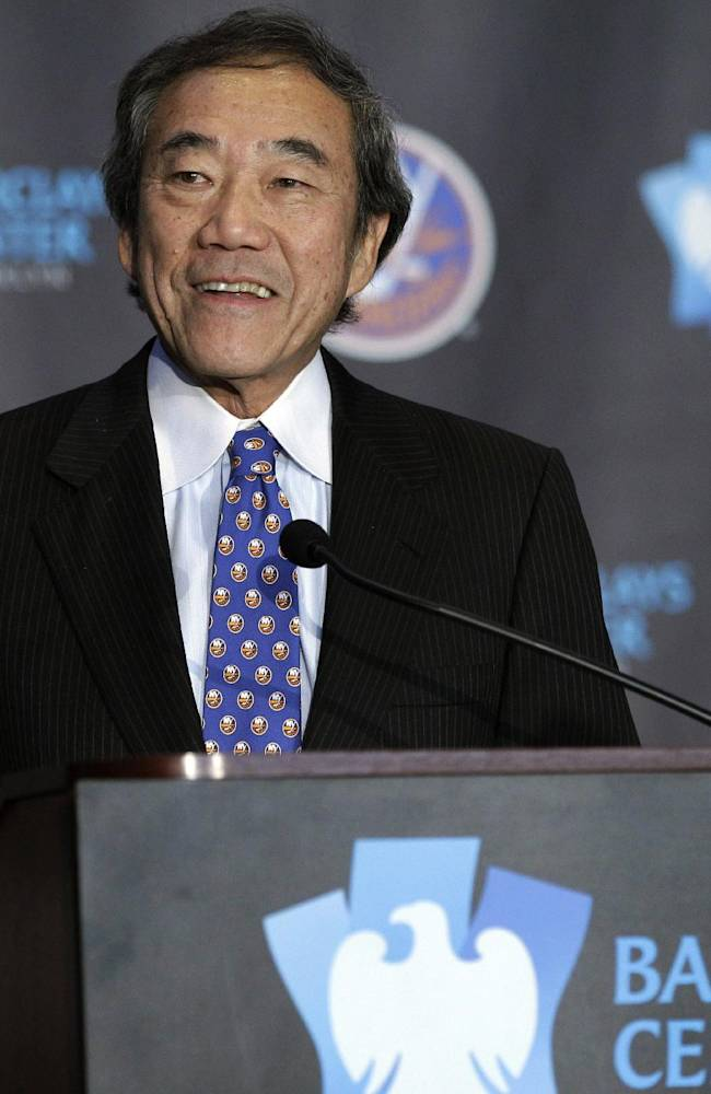This is an Oct. 24, 2012, file photo,  showing New York Islanders owner Charles Wang addressing the media during a press conference at Brooklyn's Barclays Center. The New York Islanders have announced that the team is being sold to a former Washington Capitals co-owner and a London-based investor. In a statement Tuesday, Aug. 19, 2014, the team says a group led by former Capitals co-owner Jon Ledecky and investor Scott Malkin has reached an agreement to buy a