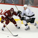 Arizona Coyotes left wing Lauri Korpikoski (28) and Los Angeles Kings defenseman Matt Greene (2) battle for the puck in the third period during an NHL hockey game, Thursday, Dec. 4, 2014, in Glendale, Ariz The Associated Press