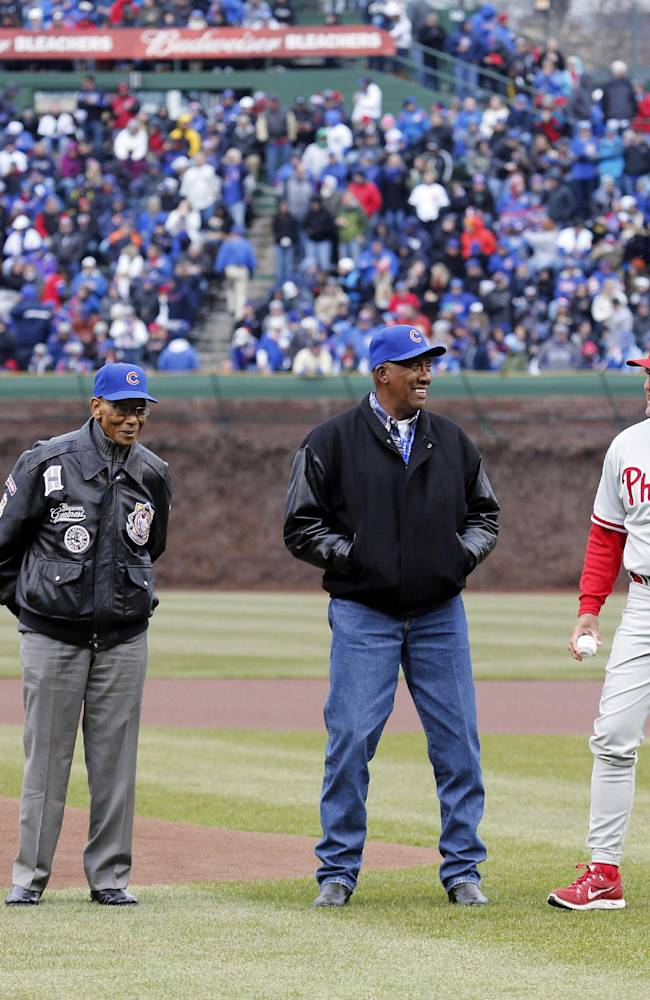 Chicago Cubs Hall of Famers, from left, Billy Williams, Ernie Banks, Ferguson Jenkins and Ryne Sandberg, the latter now manager of the Philadelphia Phillies, prepare to toss out ceremonial first pitches before a baseball game between the Phillies and the Cubs on Friday, April 4, 2014, in Chicago