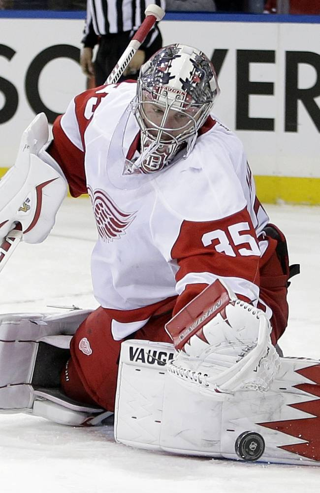 Detroit Red Wings goalie Jimmy Howard (35) stops a shot on goal during the second period of an NHL hockey game against the New York Rangers, Sunday, March 9, 2014, in New York