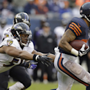 Chicago Bears running back Matt Forte (22) reludes a tackle by Baltimore Ravens linebacker Daryl Smith (51) during the first half of an NFL football game, Sunday, Nov. 17, 2013, in Chicago The Associated Press