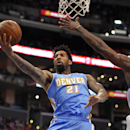 Denver Nuggets forward Wilson Chandler, left, puts up a shot as Los Angeles Clippers center DeAndre Jordan defends during the second half of an NBA basketball game, Tuesday, April 15, 2014, in Los Angeles. The Clippers won the game 117-105 The Associated