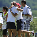 Lexi Thompson, left, and Christie Kerr celebrate after defeating Spain on the 16th hole during the second round of the International Crown golf tournament Friday, July 25, 2014, in Owings Mills, Md. (AP Photo/Gail Burton)