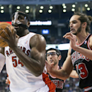 Toronto Raptors' Patrick Patterson, left, shields the ball from Chicago Bulls' Joakim Noah during the first half of an NBA basketball game, Wednesday, Feb. 19, 2014 in Toronto The Associated Press