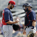 Cleveland Indians' Travis Banwart talks with catcher Matt Treanor, right, in the first inning of a spring training baseball game against the Seattle Mariners, Wednesday, March 5, 2014, in Peoria, Ariz. Banwart lasted just two-thirds of an inning and allow