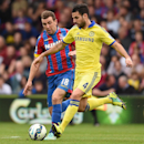 Chelsea's Cesc Fabregas, right, competes for the ball with Crystal Palace's James McArthur during their English Premier League soccer match at Selhurst Park, London, Saturday, Oct. 18, 2014