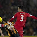 Southampton's Maya Yoshida, right, fights for the ball against Hull City's Shane Long during their English Premier League soccer match at the KC Stadium, Hull, England, Tuesday Feb. 11, 2014