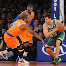 Boston Celtics' Kris Humphries (43) keeps the ball away from New York Knicks' Metta World Peace (51) and Carmelo Anthony (7) during the second half an NBA basketball game on Sunday, Dec. 8, 2013, in New York The Associated Press