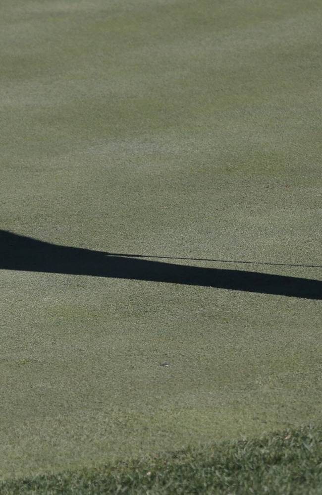 Jim Furyk casts a shadow as he hits a birdie putt on the seventh green during the second round of the BMW Championship golf tournament at Conway Farms Golf Club in Lake Forest, Ill., Friday, Sept. 13, 2013. Furyk posted a single round 59, tying a the PGA Tour record
