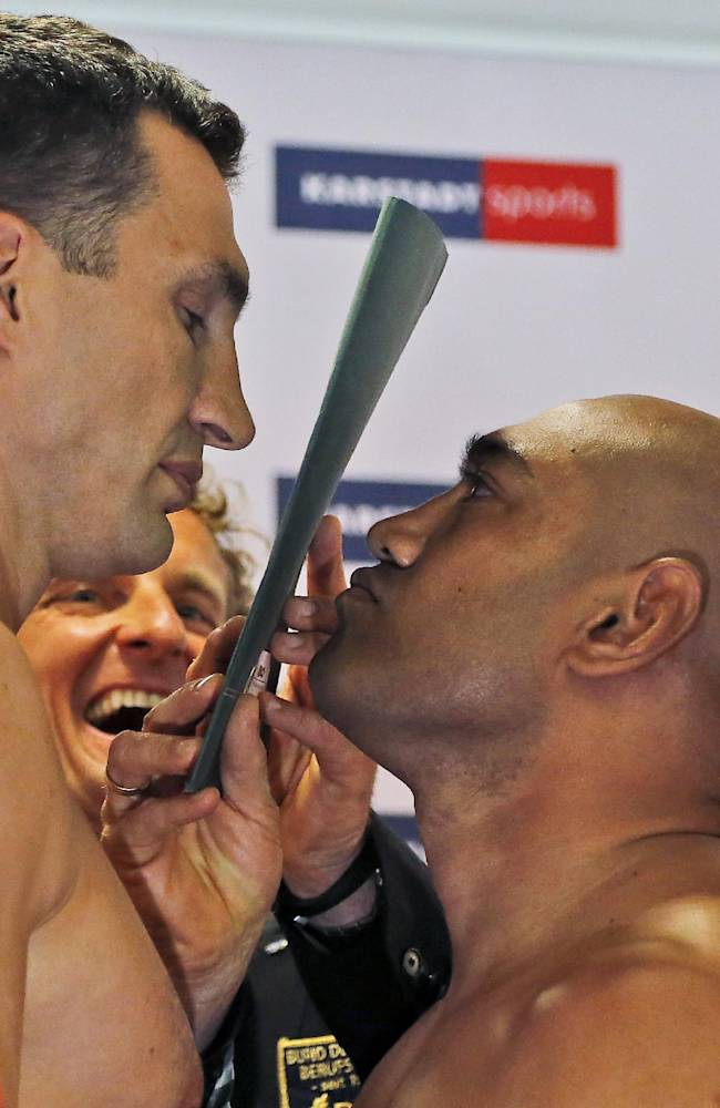 Boxing challenger Alex Leapai from Australia-Samoa, right, and world boxing champion Wladimir Klitschko of Ukraine, look at each others during the official stare down ahead of their IBF, IBO, WBO and WBA heavyweight title bout, in Muelheim, Germany, Friday, April 25, 2014