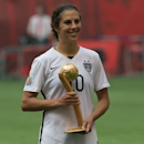 United States' Carli Lloyd holds her Golden Ball award which was presented after the United States defeated Japan to win the FIFA Women's World Cup soccer championship in Vancouver, British Columbia, Canada, Sunday, July 5, 2015. (Jonathan Hayward/The Canadian Press via AP) MANDATORY CREDIT
