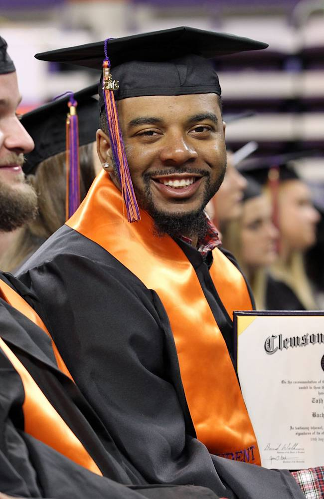 Clemson NCAA college football quarterback Tajh Boyd shows off his degree in sociology duricommencement ceremonies at Littlejohn Coliseum in Clemson, S.C. on Thursday, Dec. 19, 2013