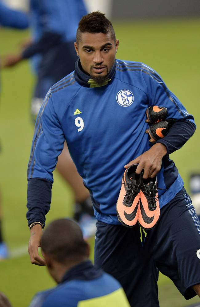 Schalke's Kevin-Prince Boateng of Ghana arrives at the last training session prior the Champions League Group E soccer match between FC Schalke 04 and Steaua Bucharest in Gelsenkirchen, Germany, Tuesday, Sept. 17, 2013