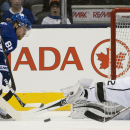 Toronto Maple Leafs forward Phil Kessel (81) gets stopped by Los Angeles Kings goalie Jonathan Quick, right, during third period NHL hockey action in Toronto on Sunday, Dec. 14, 2014 The Associated Press