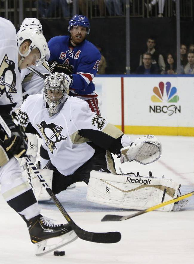 Pittsburgh Penguins goalie Marc-Andre Fleury (29) keeps his eye on the puck with Penguins defenseman Olli Maatta (3) of Finland defending against New York Rangers right wing Martin St. Louis (26)  in the second period of Game 6 of an NHL hockey second-round hockey playoff series, Sunday, May 11, 2014, in New York