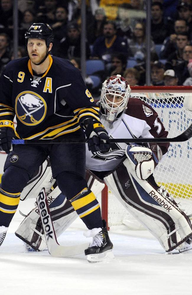 Buffalo Sabres center Steve Ott (9) screens Colorado Avalanche goaltender Jean-Sebastien Giguere (35) during the first period of an NHL hockey game in Buffalo, N.Y., Saturday, Oct. 19, 2013